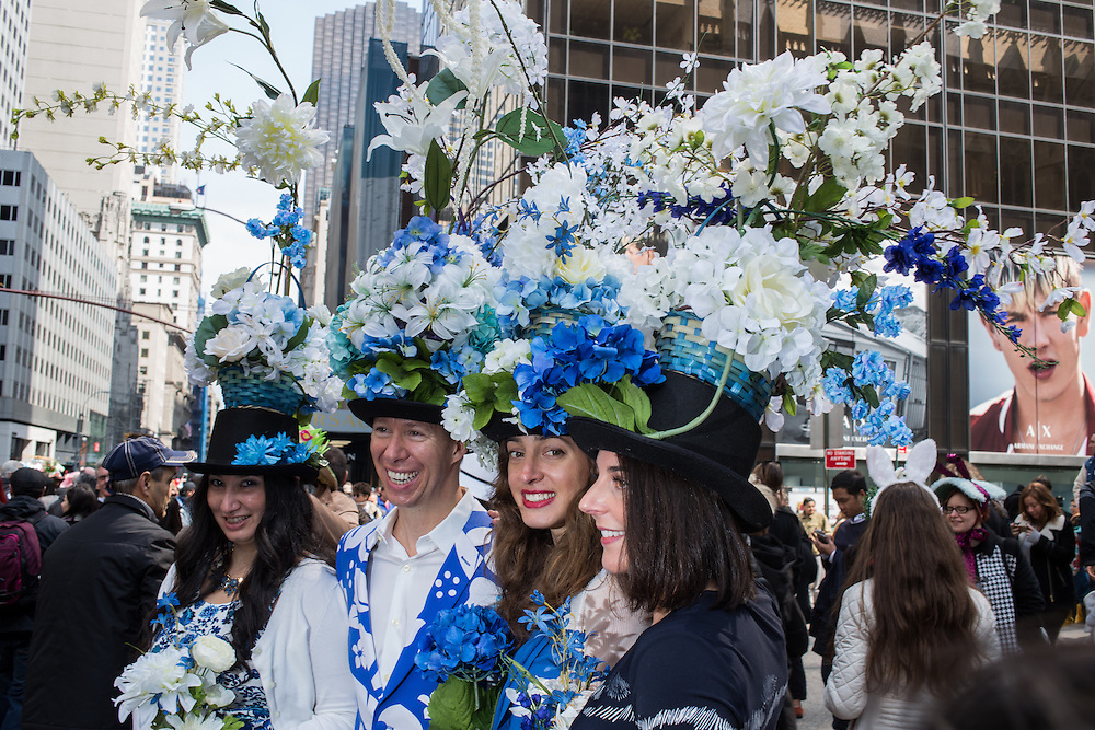 New York, NY, USA-27 March 2016. A foursome wearing identical hats of baskets of blue and white flowers in the annual Easter Bonnet Parade and Festival.
