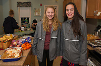 The Laconia High School Key Club prepares and serves a meal at the Belknap House on Wednesday evening.  (Karen Bobotas/for the Laconia Daily Sun)