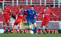 Photo: Alan Crowhurst.<br />Swindon Town v Morecambe. The FA Cup. 02/12/2006.<br />Morecambe's Gary Thompson (C) attacks.