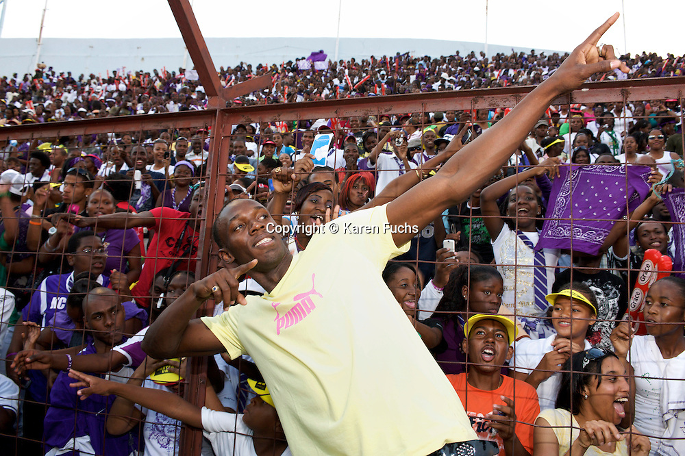 Usain Bolt in front of his 'homecrowd' KC, Kingston CollegeBoys & Girls High School Champs Kingston, Jamaica, April'09