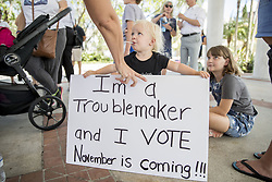 October 6, 2018 - Fort Lauderdale, FL, USA - Children join the protest against the nomination of Judge Brett Kavanaugh to the Supreme Court, in Fort Lauderdale, Fla., on Saturday, Oct. 6, 2018. (Credit Image: © Jennifer Lett/Sun Sentinel/TNS via ZUMA Wire)