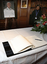 © Licenced to London News Pictures. 09/12/2013. London. UK.  <br /> General view of a picture of Nelson Mandela alongside a condolence book at the South African High Commission at South Africa House in London, December 9th 2013. <br /> Photo Credit: Susannah Ireland