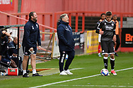 Crawley Town Assistant Coach Lee Bradbury and Crawley Town Head Coach John Yems react after a decision had gone against them during the EFL Sky Bet League 2 match between Cheltenham Town and Crawley Town at Jonny Rocks Stadium, Cheltenham, England on 10 October 2020.