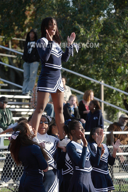 Beacon, New York - Poughkeepsie cheerleaders perform during a high school football game on Saturday, Oct. 10, 2009.