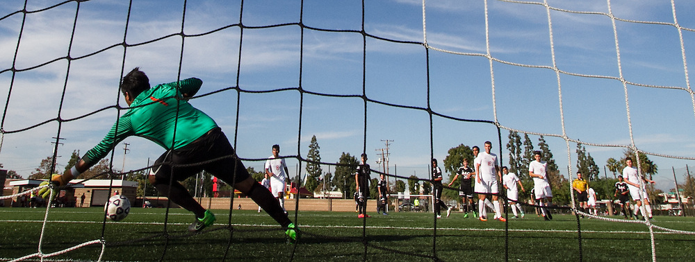 Orange Coast College Goalkeeper Osiel Porcayo defends the goal during in the 1st half of their game against Santa Ana College. 11/4/16-4:09:53 PM