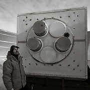John Kovac, PI for the Keck Array upgrade project standing next to the Keck Array Telescope inside the ground shield on the roof of the Martin A Pomerantz Observatory, South Pole.