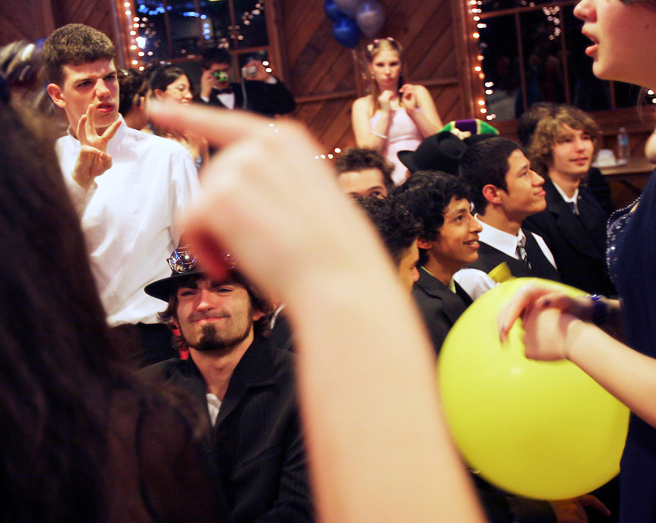 Conversation flies around the room in sign language as the Oregon School for the Deaf holds its prom at Mission Mill Museum, April 21, 2007.
