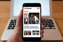 Using iPhone smartphone to display headlines page from Apple News app