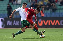 Marko Vesovic (R) of Montenegro in action against Georgi Kostadinov (R) of Bulgaria during the EURO 2020 UEFA Qualifier Group A match between Bulgaria and Montenegro at The Vasil Levski Stadium in Sofia, Bulgaria, 22 March 2019.