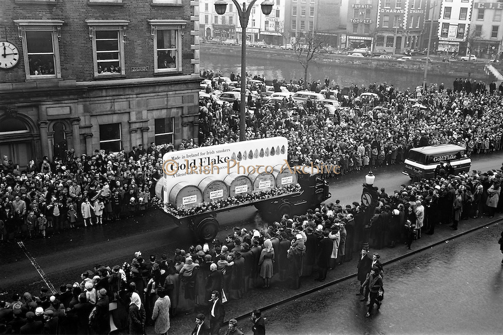 17/03/1965<br /> 03/17/1965<br /> 17 March 1965<br /> NAIDA St. Patrick's Day Parade, Dublin. W. D.& H. O. Wills float  and van in the parade on Westmoreland Street, the truck is a Dublin Port and Docks Scammmel Scarab.