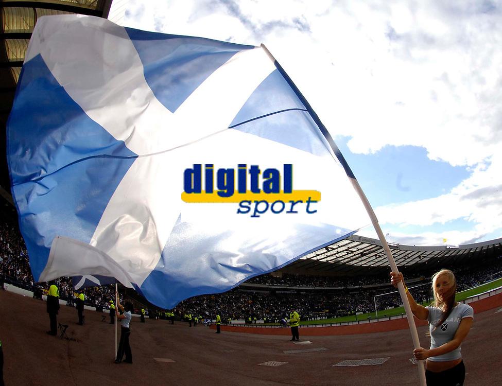 Photo: Jed Wee/Sportsbeat Images.<br /> Scotland v Ukraine. UEFA European Championships Qualifying. 13/10/2007.<br /> <br /> A Scottish flag bearer captures the mood at Hampden Park as Scotland hope to keep their hopes of qualification.