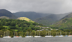 File photo dated 22/96/11 of a general view showing Coniston village and fells from Lake Coniston in the Lake District, as the Lake District has been designated as a World Heritage Site, Unesco has said.