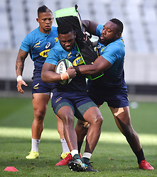 Cape Town-180619 Springbok captain Siya Kolisi tackled by Tendai Mtawarira during their training session at Cape Town stadium,the team is preparing for the last test  against England at Newslands on Saturday..Photographer:Phando Jikelo/African News Agency/ANA