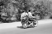 Family on motorcycle blur by