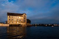 Norway, Stavanger, Hundvåg. Kayaking. Old building at sunset.