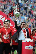 Cardiff city players celebrate as manager Malky Mackay lifts the championship trophy.  NPower championship, Cardiff city v Bolton Wanderers at the Cardiff city Stadium in Cardiff, South Wales on Saturday 27th April 2013. pic by Andrew Orchard,  Andrew Orchard sports photography,
