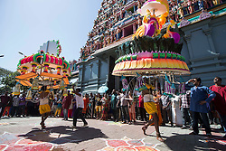 © Licensed to London News Pictures. 03/02/2015. Ipoh, Malaysia. Devotees with metal sticks pieced through their mouths carrying their kavadi dance in front of Kallumalai Murugan Temple in Ipoh, Malaysia, during the Thaipusam Festival,  Tuesday, Feb. 3, 2015. Photo credit : Sang Tan/LNP