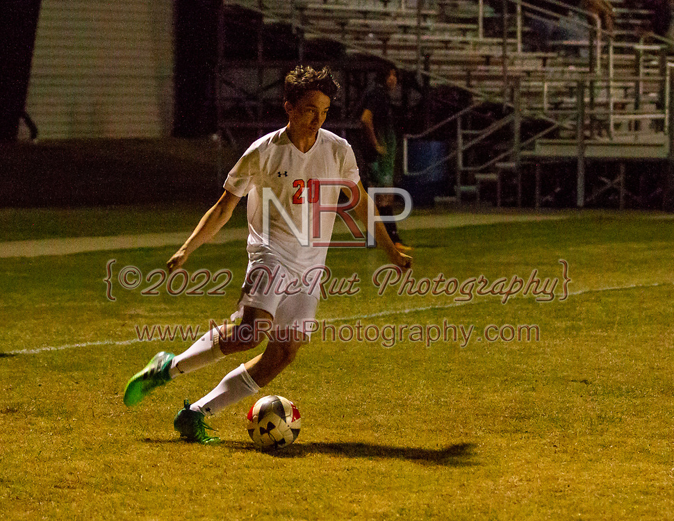 #20 Heath Williamson looking to pass the ball his teammates during their game against Bishop McGuinness on April 24, 2018.