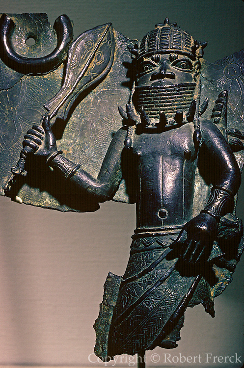 WEST AFRICA, NIGERIA Benin bronze casting showing a warrior with sword and armor; from the 16th or 17th  centuries: Art Institute of Chicago