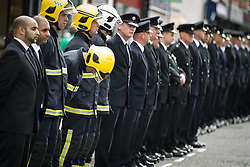 © Licensed to London News Pictures . 02/09/2013 . Bury , UK . 100s of fire service personnel lined the streets of Bury leading up to the church . The funeral of fireman Stephen Hunt at Bury Parish Church today (Tuesday 3rd September 2013) . Stephen Hunt died whilst tackling a blaze at Paul's Hair World in Manchester City Centre in July 2013 . Photo credit : Joel Goodman/LNP