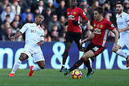 Michael Carrick of Manchester Utd ® is challenged by Wayne Routledge of Swansea city. Premier league match, Swansea city v Manchester Utd at the Liberty Stadium in Swansea, South Wales on Sunday 6th November 2016.<br /> pic by  Andrew Orchard, Andrew Orchard sports photography.