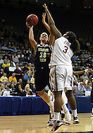 24 MARCH 2009: Georgia Tech forward Brigitte Ardossi (35) tries to shoot over Oklahoma center Courtney Paris (3) during an NCAA Women's Tournament basketball game Tuesday, March 24, 2009, at Carver-Hawkeye Arena in Iowa City, Iowa. Oklahoma defeated Georgia Tech 69-50.