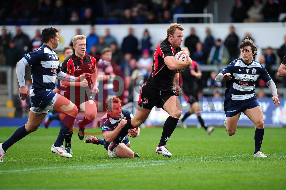 Ulster Ravens' Roger Wilson powers his way past the Bristol defence and avoids the challenge from Bristol Rugby's James Grindal before scoring his try - Photo mandatory by-line: Dougie Allward/JMP  - Tel: Mobile:07966 386802 21/10/2012 - SPORT - Rugby Union - British and Irish Cup -  Bristol  - The Memorial Stadium - Bristol Rugby V Ulster Ravens
