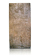 Assyrian relief sculpture panel  of a protective spirits holding a bucket of holy water wearing a rosette bracelet which symbolises divine power. From Nimrud, Iraq.  865-860 B.C North West Palace, Room S, door c.  British Museum Assyrian  Archaeological exhibit  ref WA 118803 .<br /> <br /> If you prefer to buy from our ALAMY PHOTO LIBRARY  Collection visit : https://www.alamy.com/portfolio/paul-williams-funkystock/ancient-assyria-antiquities.html  Refine search by adding background colour, place, subject, museum etc into the LOWER SEARCH WITHIN GALLERY box to <br /> <br /> Visit our ANCIENT ASSYRIAN PHOTO COLLECTIONS for more photos to download or buy as wall art prints https://funkystock.photoshelter.com/gallery-collection/Ancient-Assyrian-Art-Artefacts-Antiquities-Historic-Sites-Pictures-Images-of/C0000cjRqQyJjLag