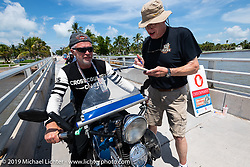 Gary Shorman riding his 1940 Harley-Davidson WL750cc Flathead through a checkpoint of the Cross Country Chase motorcycle endurance run from Sault Sainte Marie, MI to Key West, FL. (for vintage bikes from 1930-1948). The staging area on a Key West pier just before the finish and near the end of the 110 mile Stage-10 ride from Miami to Key West, FL USA. Sunday, September 15, 2019. Photography ©2019 Michael Lichter.