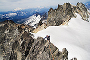 Brian Polagye ascends the thin Northwest Ridge of Dorado Needle, a rocky spire in the heart of North Cascades National Park, Washington.