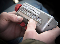 Chornic wasting disease biologist Chris Timberlake uses an old tabulator to keep track of elk counted on the refuge.