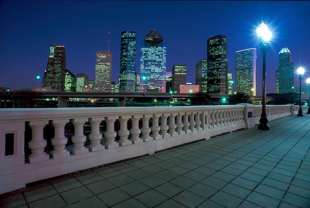 Houston, Texas skyline from the Sabine Street Bridge at night.