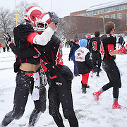 Sterling Guynn, (left), New Canaan, celebrates with team mate Jarrett Torromeo after victory during the New Canaan Rams Vs Darien Blue Wave, CIAC Football Championship Class L Final at Boyle Stadium, Stamford. The New Canaan Rams won the match in snowy conditions 44-12. Stamford,  Connecticut, USA. 14th December 2013. Photo Tim Clayton