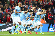 Manchester city players celebrate the win over Liverpool after the penalty shoot out.  Capital One Cup Final, Liverpool v Manchester City at Wembley stadium in London, England on Sunday 28th Feb 2016. pic by Chris Stading, Andrew Orchard sports photography.