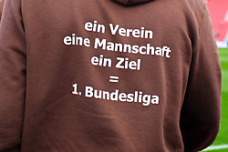 """10.04.2011,  BayArena, Leverkusen, GER, 1. FBL, Bayer Leverkusen vs FC St. Pauli, 29. Spieltag, im Bild:  """"ein Verein eine Mannschaft ein Ziel = 1 Bundesliga"""" steht auf dem Shirt von St. Pauli EXPA Pictures © 2011, PhotoCredit: EXPA/ nph/  Mueller       ****** out of GER / SWE / CRO  / BEL ******"""