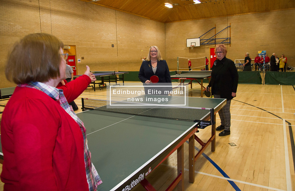 """Pictured: Equalities Minister Christina McKelvie and Christine Grahame took up the challenge of a game of table tennis and took things rather seriously<br /> .<br /> Equalities Minister Christina McKelvie visited Ladywood Leisure Centre in Penicuik today where she was joined by local MSP Christine Grahame to meet volunteers and participants at the centre as she launched the new framework<br /> <br /> Older people's rights are at the centre of a new framework to ensure people can remain active, keep working if they want to, feel safe, and access the services they need.  The Older People's Framework aims to challenge unwelcome attitudes to and discrimination towards older people. It highlights the positive contributions older people make to our society and the economy, and has been directly influenced by older people who have provided their thoughts, stories and experiences, bringing to life the issues they've faced over the years.<br />  <br /> Speaking at a visit to The Ageing Well Midlothian programme, Older People and Equalities Minister Christina McKelvie said: """"Ageing is inevitable but growing older should not mean having to face barriers or discrimination, and one of the issues the framework addresses is the negative perceptions surrounding ageing. Older people in our society have much to offer and contribute and we are committed to supporting them.  This is why we are funding the celebration of older people at the Festival of Ageing, increasing digital inclusion, promoting fair workplace practices and ensuring we have a housing system which works for an ageing population. This framework is the next part of the journey and I am looking forward to an exciting trip, where we all work together to create the best country to age in.  You only need to look at the Ageing Well project to see the many positive examples of older people enjoying life and bringing joy to their local community. This is what we need to encourage.""""<br /> <br /> <br /> Ger Harley   EEm 3 April"""