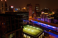 Tennis court illuminated in the middle of the night in Shanghai is one of the sign of the rise of China as economic power on the world stage, China.
