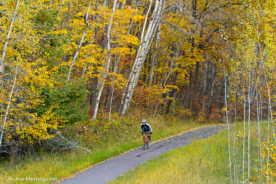 Bicycling on the Willard Munger Trail near Duluth, Minnesota, USA model released