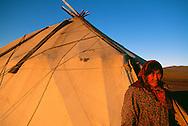 Old Chukchi woman in front of her traditional Yaranga tent, Chukotka, Siberia, Russia, Arctic