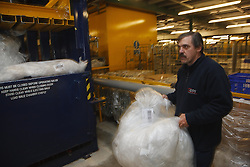Man with a mild learning disability working as a factory operative, shown here recycling plastic, helped into employment by the Ready 4 Work team, Nottinghamshire County Council