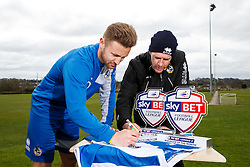 Sky Bet Football League 2 Player of the Month Matty Taylor and Manager of the Month Darrell Clarke, both of Bristol Rovers, sign a shirt - Mandatory byline: Rogan Thomson/JMP - 07/04/2016 - FOOTBALL - The Lawns Training Ground - Bristol, England - Sky Bet Football League Awards.