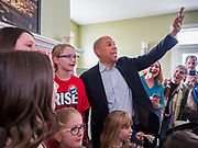 """31 DECEMBER 2019 - ANKENY, IOWA: US Senator CORY BOOKER (D-NJ) does a """"Happy Noon Year"""" countdown after he made a speech at a campaign house party in Ankeny, a suburb of Des Moines. The family that hosted Sen. Booker does a """"Noon Year"""" countdown with their children every year. Sen Booker is campaigning in Iowa over New Years to support his candidacy for the US Presidency. Iowa traditionally holds the first event of the presidential election cycle. The Iowa caucuses are Feb. 3, 2020.          PHOTO BY JACK KURTZ"""