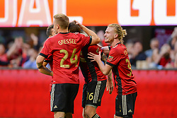 October 21, 2018 - Atlanta, GA, U.S. - ATLANTA, GA Ð OCTOBER 21:  Atlanta's Julian Gressel (24) and Andrew Carleton (30) celebrate after Chris McCann (16) had his shot deflected into the goal during the match between Atlanta United and the Chicago Fire on October 21st, 2018 at Mercedes-Benz Stadium in Atlanta, GA.  Atlanta United FC defeated the Chicago Fire by a score of 2 to 1.  (Photo by Rich von Biberstein/Icon Sportswire) (Credit Image: © Rich Von Biberstein/Icon SMI via ZUMA Press)