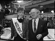 The 1989 Boat Show.   (R89)..1989..10.03.1989..03.10.1989..10th March 1989..Pat the Cope GallagherTD, Minister for the Marine attended the opening of the 1989 Boat Show held at the Point Depot, Dublin. The opening coincided with the minister's birthday...Minister Gallagher is pictured with Aisling Roche, Miss Boat Show, as she wishes him well on his birthday.