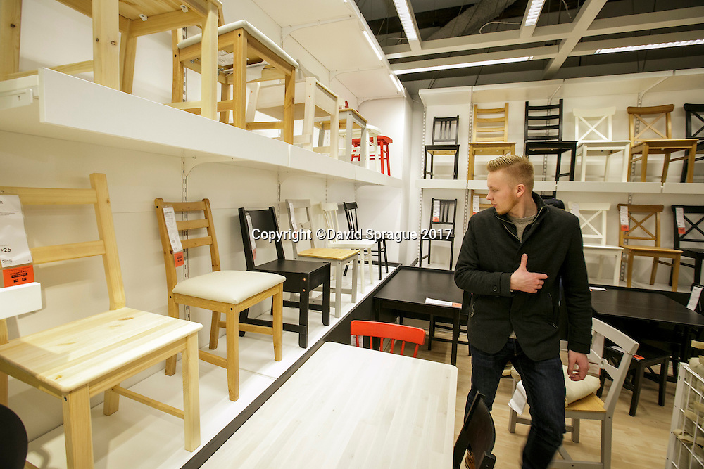 A man looks at some chairs at the grand opening of the new Ikea in Burbank. The new Ikea store comes in at 456,000 sf, compared to the old one at 242,000 sf. And 1,700 parking places.  Feb. 8, 2017  Photo by David Sprague