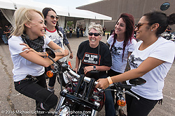 Iron Lilies (L>R) Leticia Cline, Kissa Von Addams, Sarah Furey and Samantha Campana joke with Sue Woolf after Sue returned from one of her many test rides int the Harley-Davidson demo ride area during the annual Sturgis Black Hills Motorcycle Rally.  SD, USA.  August 12, 2016.  Photography ©2016 Michael Lichter.
