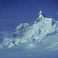 "A crag of Pilcher Peak known as ""Wiltsie's Peak"" rises above the Calley Glacier on the Antarctic Peninsula, Antarctica."