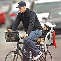 Tom Brady and son John Moynahan, bicycle in and around Boston. Photo by Mark Garfinkel