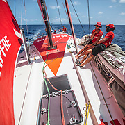 Leg 6 to Auckland, day 15 on board MAPFRE, Sophie Ciszek talking with blair at the bow, Xabi Fernandez Trimming and Pablo Arrarte stearing  . 21 February, 2018.