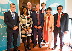 © Licensed to London News Pictures. 23/04/2019. London, UK. Candidate James Glancy (L), Candidate Christina Jordan (2L), candidate Matthew Patten (3L), Brexit Party leader Nigel Farage (C), Brexit Party Chairman Richard Tice (3R), candidate Claire Fox (2R) and candidate Lance Forman (R) pose for a photograph at a Brexit Party candidate launch event in London. Nigel Farage launched his new political party, the Brexit Party earlier this month, to campaign for the European elections. Photo credit: Vickie Flores/LNP